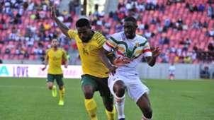 Thulani Hlatshwayo of Bafana Bafana and Hadi Sacko of Mali, October 2019