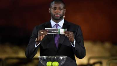 Former Ivorian midfielder Yaya Toure shows Nigeria ballot during the 2019 CAF African Cup of Nations (CAN) draw