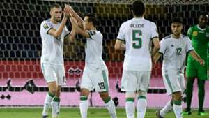 Islam Slimani celebrates with Algeria teammates