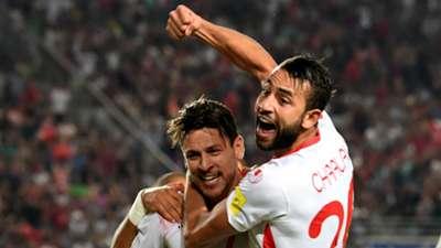 Tunisia's forward Ghailene Chaalali (R) celebrates with Youssef Msakni after scoring a goal