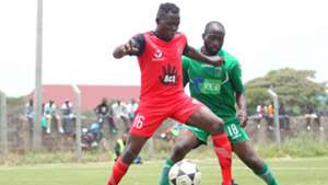 Shaban Juma of Kibera Black Stars and Dennis Orenge of KCB.