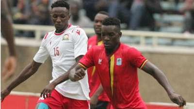Kenneth Muguna of Harambee Stars and Kenya v Khalid Aucho of Uganda.