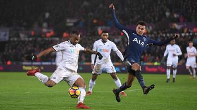 Jordan Ayew Swansea City and Dele Alli of Tottenham Hotspur