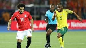 Mohamed Salah of Egypt challenged by Kamohelo Mokotjo of South Africa, July 2019