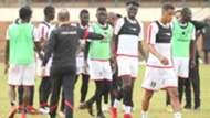 Harambee Stars coach Sebastien Migne and Jesse Were.