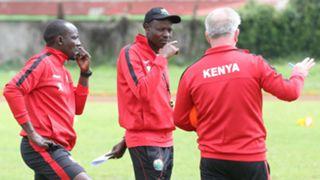 Harambee Stars coach Paul Put and Stanley Okumbi