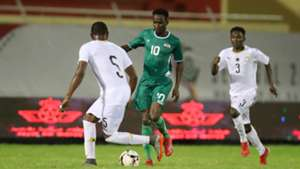 Clement Pitroipa of Burkina Faso takes on Ghana at the Wafu Cup