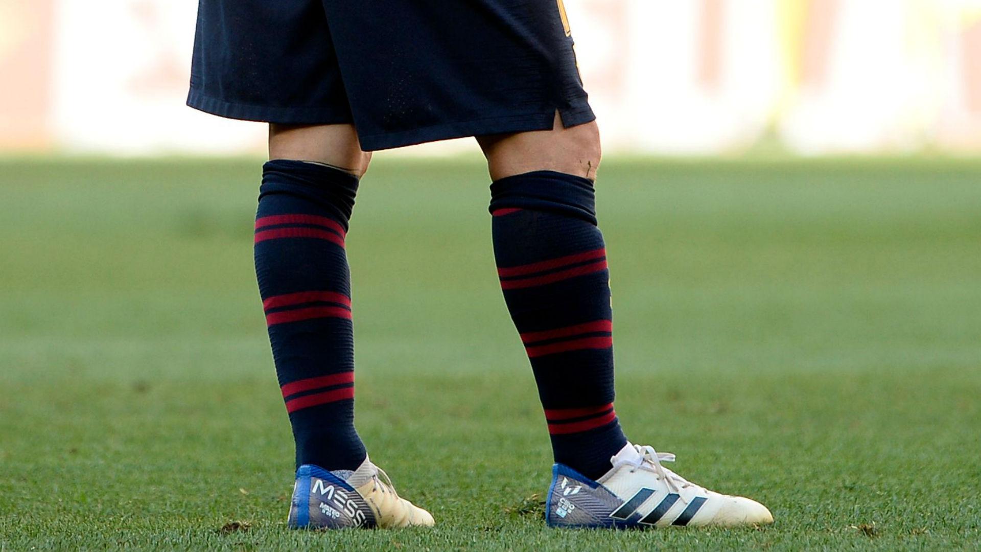 Lionel Messi and Cristiano Ronaldo wear