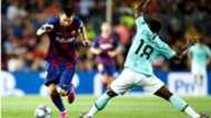 Lionel Messi and Kwadwo Asamoah - Barcelona v Inter Milan