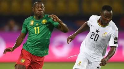 Ghana's midfielder Kwadwo Asamoah (R) is marked by Cameroon's forward Christian Bassogog during the 2019 Africa Cup of Nations.jpg