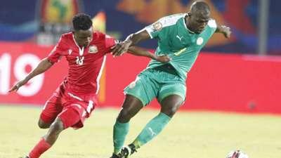 ERIC OUMA of Kenya and Harambee Stars v SOULEYMAN DOUMBIA of Senegal.