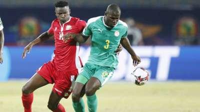 Michael OLUNGA of Kenya and Harambee Stars v KALIDOU KOULIBALY of Senegal.