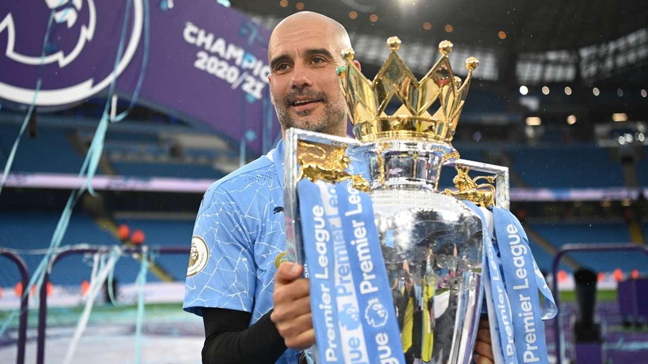 Pep Guardiola Manchester City Premier League trophy 2020-21
