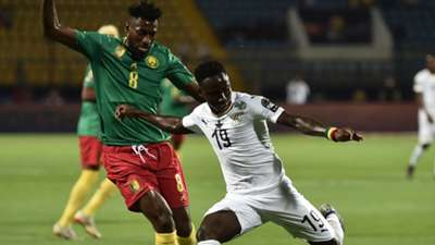 Ghana's midfielder Samuel Owusu prepares to take a shot as he is marked by Cameroon's midfielder Andre-Frank Zambo Anguissa during the 2019 Africa Cup of Nations