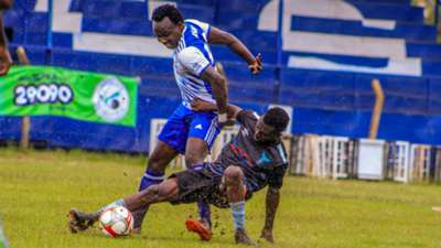Kepha Aswani of Sofapaka takes on a Kisumu All-Stars player.