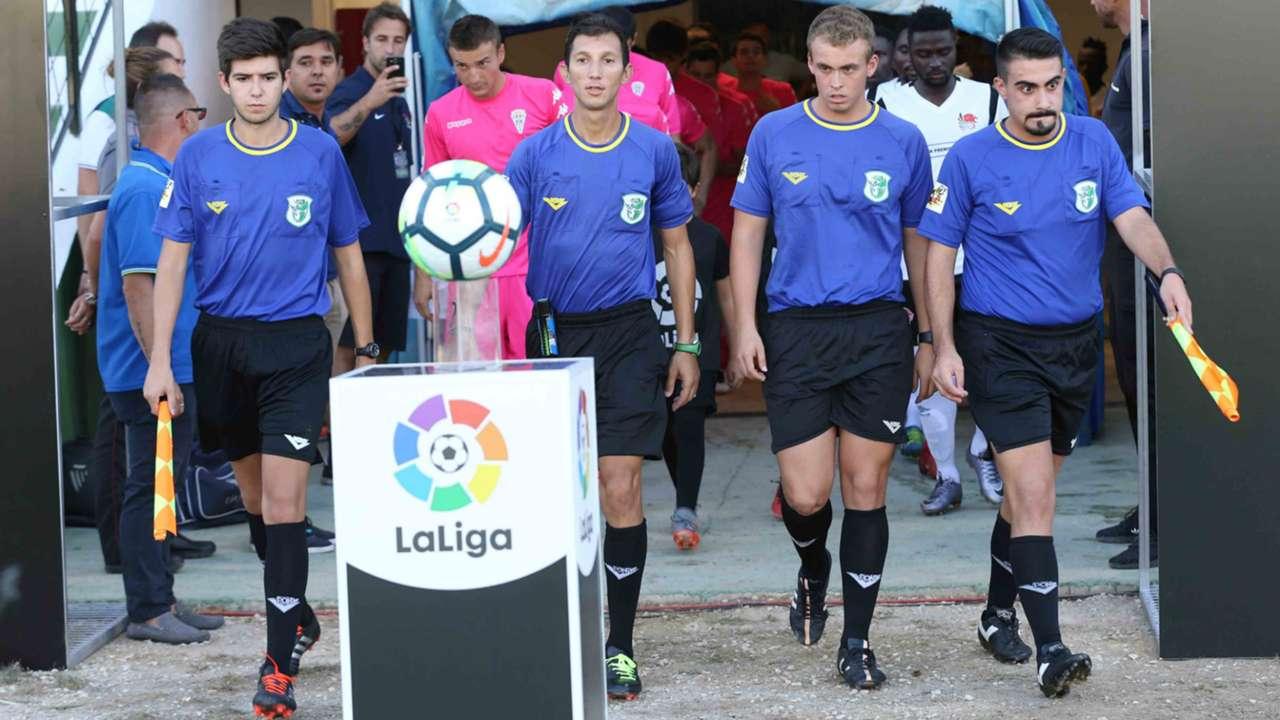KPL Match officials enter pitch