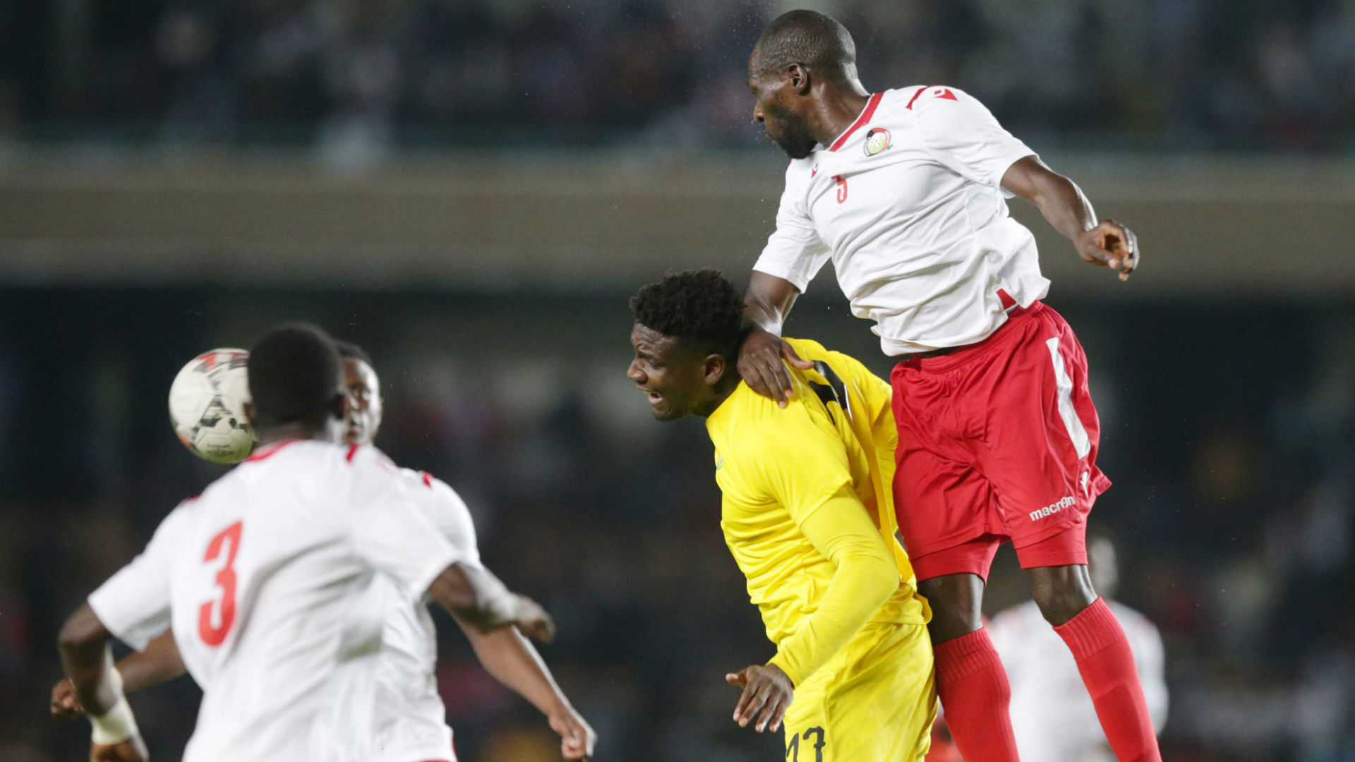 Joash Onyango of Kenya and Harambee Stars vs defends against Peniel Kokou of Togo.