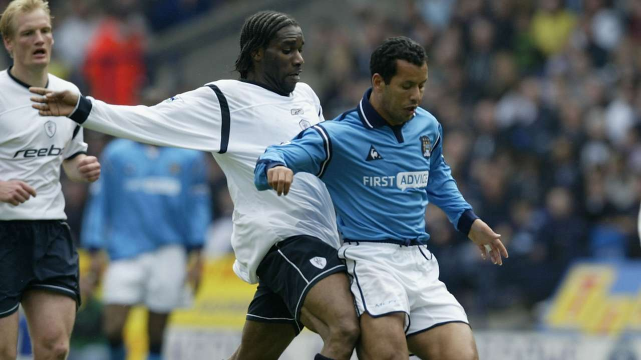 Jay-Jay Okocha of Bolton and Ali Benarbia of Man City