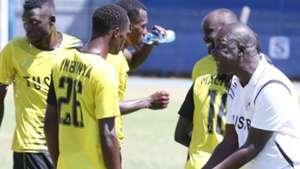 Tusker coach Robert Matano and Ambinya.