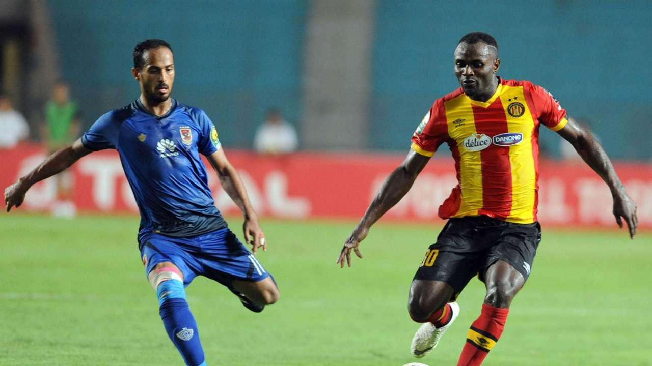 Esperance Sportive de Tunis player Franck Kom (R) and Al Ahly SC player Walid Said Ebeid, August 2018