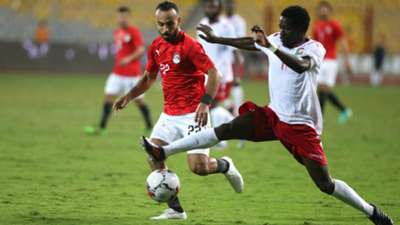 Kenya's and Harambee Stars Lawrence Juma (r) in action against Egypt p;layer Mohamed Afsha.