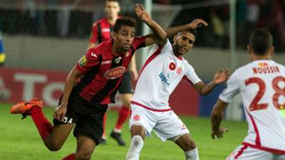 Wydad Casablanca's Mohammed Ounnajem (white) vies for the ball with the USM Alger's Mohamed Benkhemassa