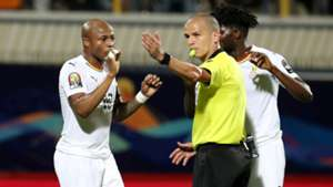 Andre Ayew and Thomas Teye Partey of Ghana, referee Victor Gomes, 2019 Afcon