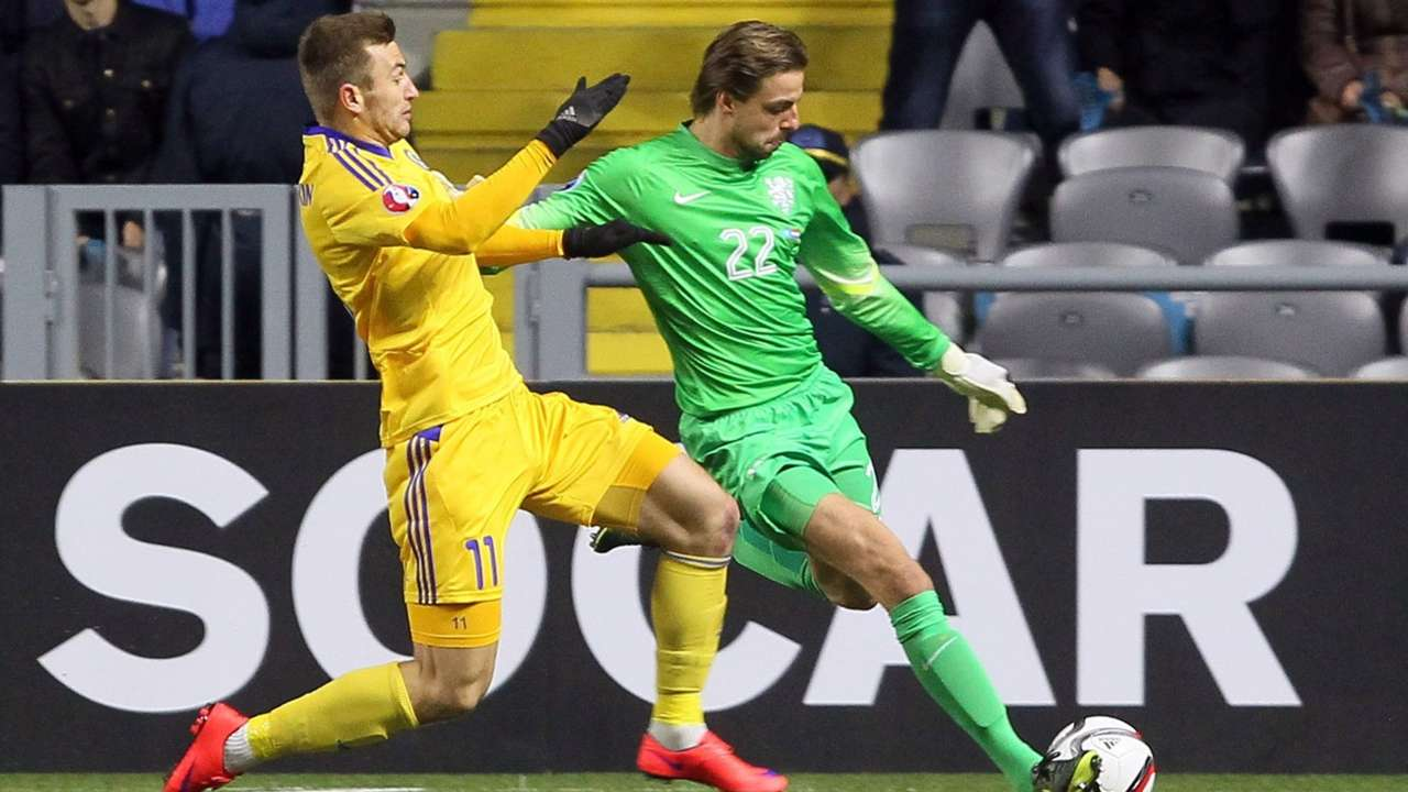Netherlands' Tim Krul chased down by a Kazakhstan player