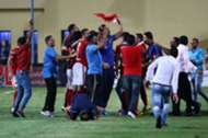 Al Ahly players celebrate winning the league title