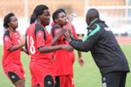 Harambee Starlets coach David Ouma issues instructions to the players at the break