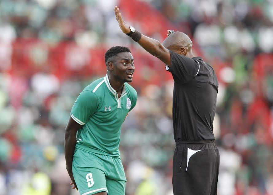 Referee Moses Osano cautions Gor Mahia captain Musa Mohammed as K'Ogalo push for the opener