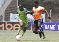 Athman Buki (l) of KCB tackles Eric Omonge of Nakuru All Stars