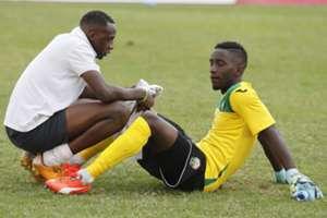 Harambee Stars goalkeeper Arnold Origi is consoled by keeper trainer Mathews Ottamax