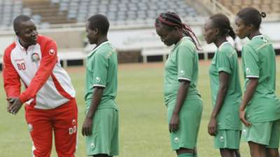 Coach David Ouma with Harambee Starlets players at Kasarani