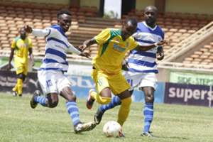 Mathare United player Daniel Mwaura dribbles past AFC Leopards' duo