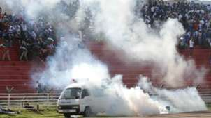 An ambulance is covered with teargas after crowd trouble