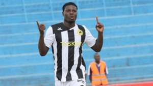 Kenyan striker Allan Wanga wheels away in delight aftrer scoring for Tusker in the final