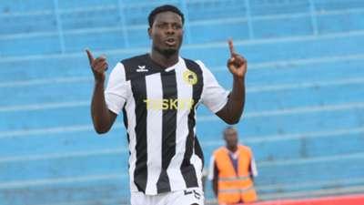 Kenyan striker Allan Wanga wheels away in delight aftrer scoring for Tusker in the final