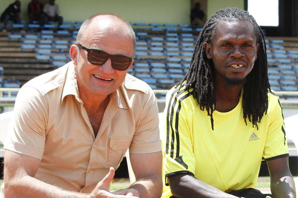 AFC Leopards coach Zdravko Logarusic and assistant Ezekiel Akwana in pensive moods before their match against Mathare United
