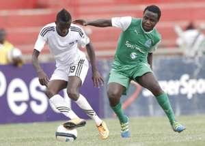 Gor Mahia midfielder Collins 'Gattuso' Okoth takes on a Nairobi City Stars player
