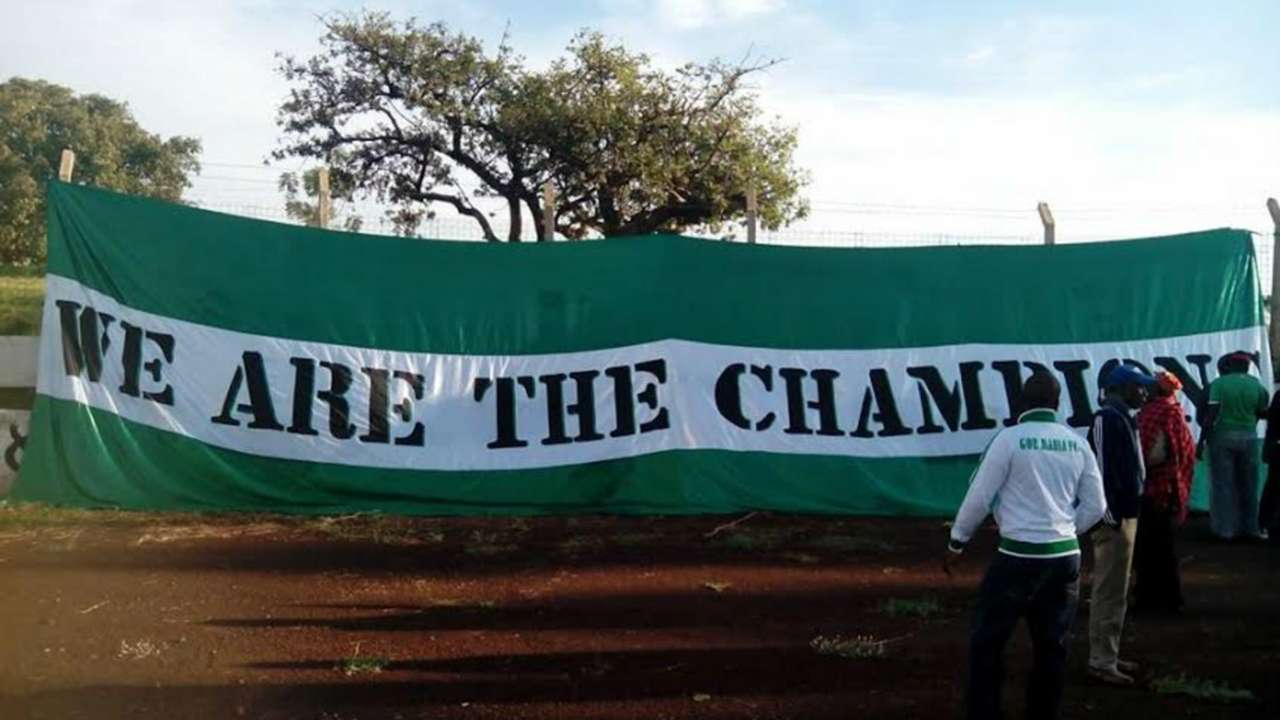 Gor Mahia fans with a banner 'We are the Champions' outside Kisumu Stadium.