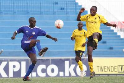 Clifford Alwanga goes for the high ball challenged by Arthur Museve of Nairobi City Stars