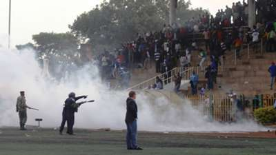 Police use teargas to disperse rowdy AFC Leopards fans against Sofapaka on Sunday.