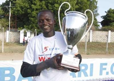 Bandari goalkeeper Wilson Obungu celebrates with DStv Cup trophy after a spending performance against Gor Mahia