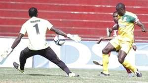 Roosevelt Blaty of Ushuru scores Mathare United keeper Robert Mboya