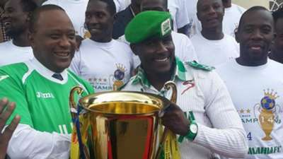 Gor Mahia fan Jaro Soja with President Uhuru Kenyatta pose with KPL trophy