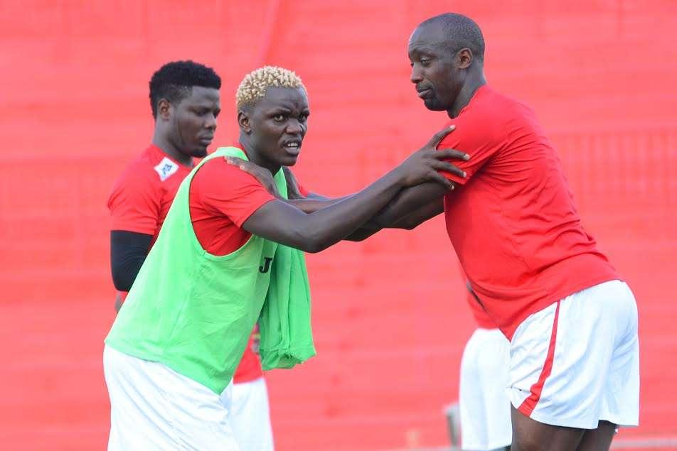 David Ochieng and Lawrence Olum stretch at Nyayo Stadium