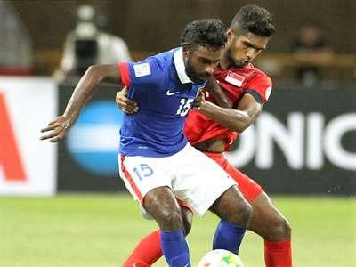 Malaysia's Gary Steven Robbat vies for the ball against Singapore's Hariss Harun 2014
