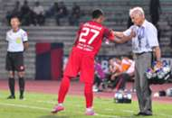 Perak head coach Karl Heinz Weigang handing out water to a PDRM player 3/8/2016