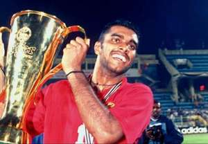 Singapore's R. Sasikumar lifting the 1998 AFF Cup